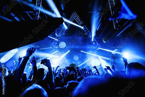 Obraz na płótnie night club party festival dj with crowd of people