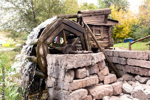 Old water mill in the park.