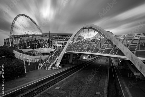 фотография The wembley stadium and wembley train station in black and white