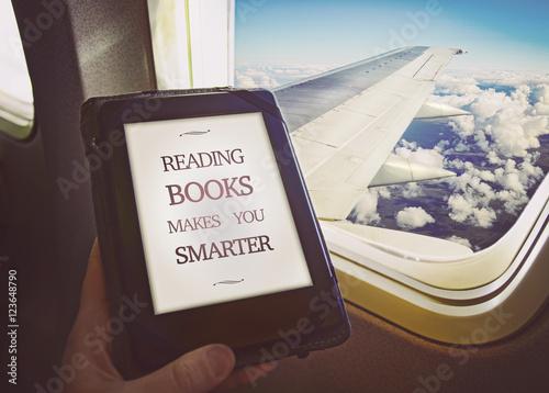 Wallpaper Mural Human reading book inside airplane. Concept art