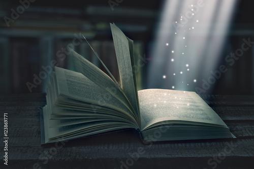 Tablou Canvas Opened magic book with magic light
