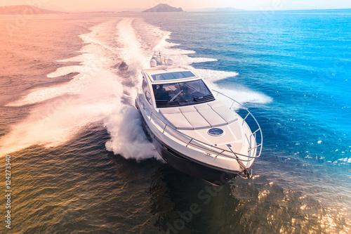 Carta da parati luxury motor boat, rio yachts italian shipyard, aerial view