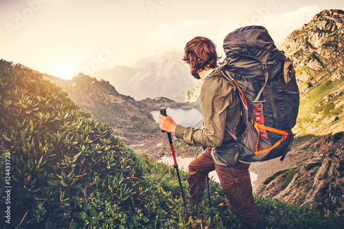 Tableau sur Toile Man Traveler with backpack mountaineering Travel Lifestyle concept lake and moun