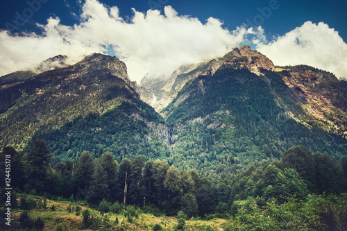 Mountains and forest Landscape in Abkhazia with blue sky and clouds Summer Travel serene scenic view.