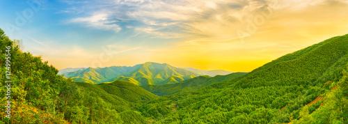 Obraz na plátně Mountain valley at sunset