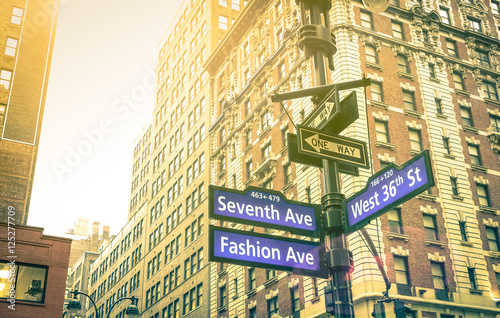 Fotografija Street sign of Seventh and Fashion Ave with West 36th St at sunset in New York C