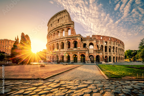 Leinwand Poster Colosseum in Rome and morning sun, Italy