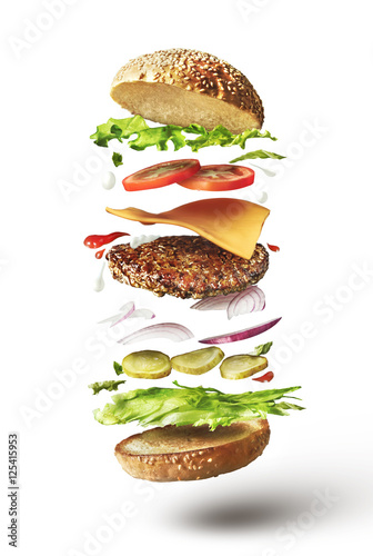 Fotografie, Tablou Delicious hamburger with flying ingredients