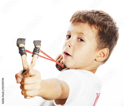 Valokuva little cute angry real boy with slingshot isolated