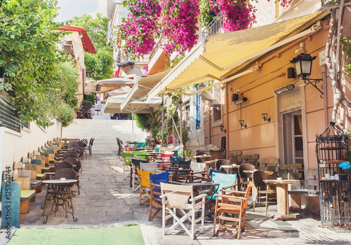 Charming street in the old district of Plaka in Athens, Greece