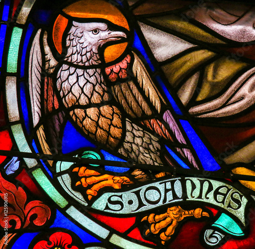 Fotografiet Stained Glass of the the Eagle - Saint John the Evangelist