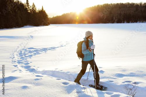 Winter hiking sport activity woman snowshoeing