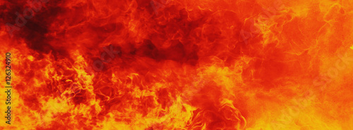 Photo background of fire as a symbol of hell and inferno