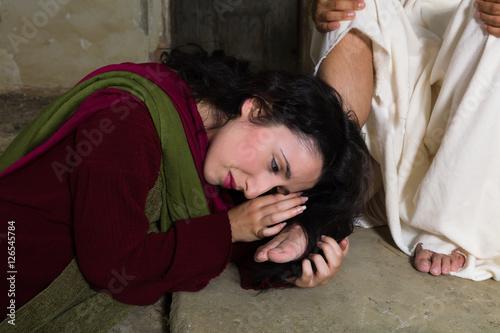 Fototapeta Mary Magdalene drying Jesus feet with her hair