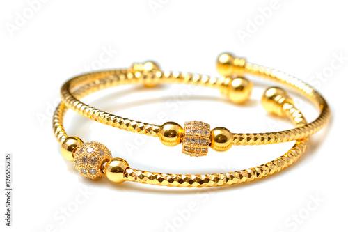 Cuadros en Lienzo Golden bracelets , isolated on white background