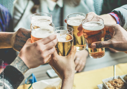 Fototapeta Group of friends enjoying a beer