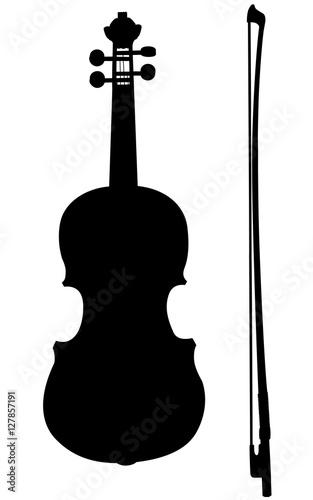 Photo Silhouette d'un violon avec son archet.