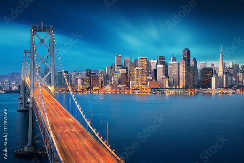San Francisco at sunrise with Bay Bridge in foreground. Amazing view to famous America city. California theme. Art Photography.