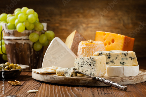 Canvas Print Mix cheese on wooden board.
