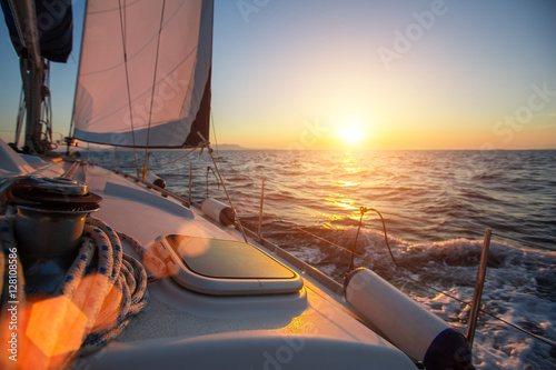 Sailing ship luxury yacht boat in the Sea during amazing sunset. Fotobehang