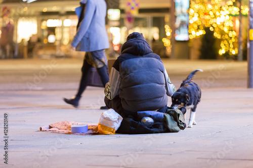 Fotografiet Bettler mit Hund