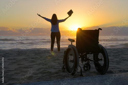 Miracle spiritual healing crippled Christian woman praying with bible stands up Fototapet