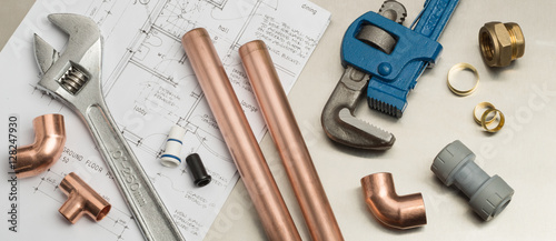 Slika na platnu Plumbers Tools and Plumbing Materials Banner on House Plans