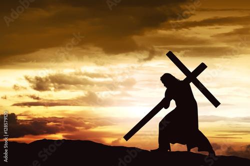 Silhouette of Jesus carry his cross Fototapete