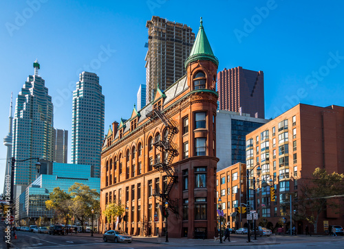 Gooderham or Flatiron Building in downtown Toronto with CN Tower on backgound - Toronto, Ontario, Canada