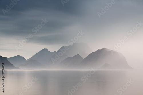 фотография Summer cloudy Lofoten islands. Norway misty fjords.