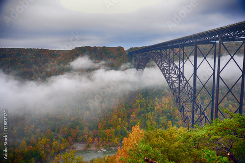 Fog in the morning going under the New River Gorge Bridge Fototapeta