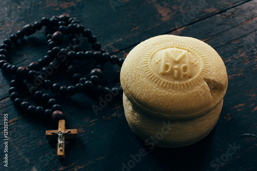 Obraz na plátne Theotokion service unleavened bread taken out with a particle for Eucharist in the Orthodox Church and the rosary with a crucifix close-up