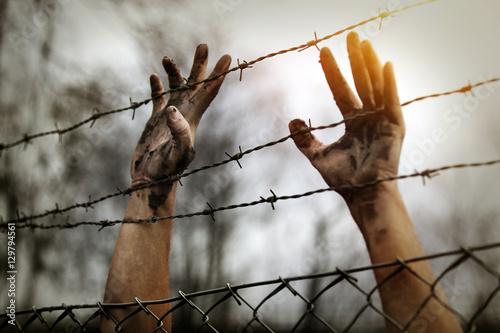 Obraz na płótnie Refugee men and fence