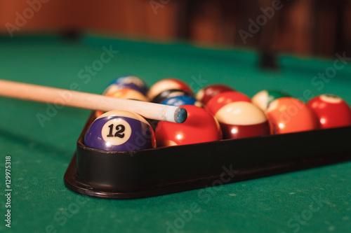 Obraz na plátně Billiard balls near by cue and chalk.
