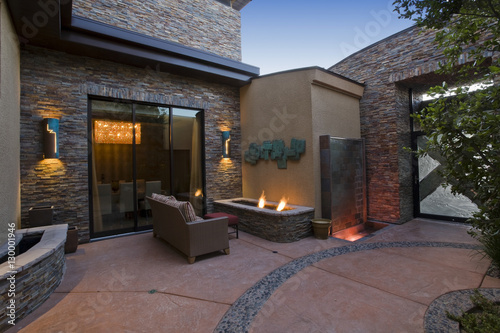 View of gas fire pit and sofa in courtyard Fototapeta