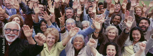 Fotografie, Tablou Large group of multi-ethnic people cheering with arms raised