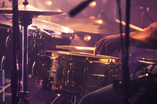 Vászonkép Drummer plays on drum set, vintage