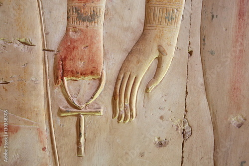 Wallpaper Mural Ankh, an ancient Egyptian symbol of eternal life, in hand of a god, on the wall
