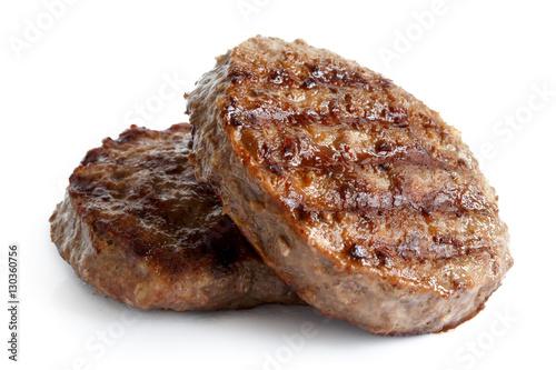 Canvastavla Two grilled hamburger patties isolated on white.