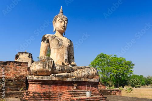 Ancient Buddha Statue at Sukhothai historical park, Thailand. Fototapeta