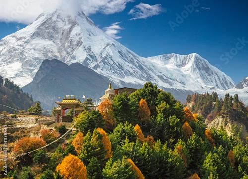 Buddhist monastery and Manaslu mount in Himalayas, Nepal.  View from Manaslu circuit trek