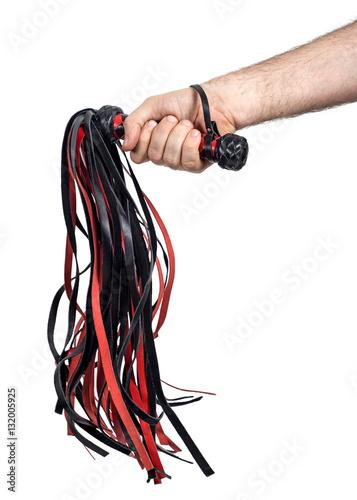 Hand grasps the whip (floger). Isolated on white Fototapet