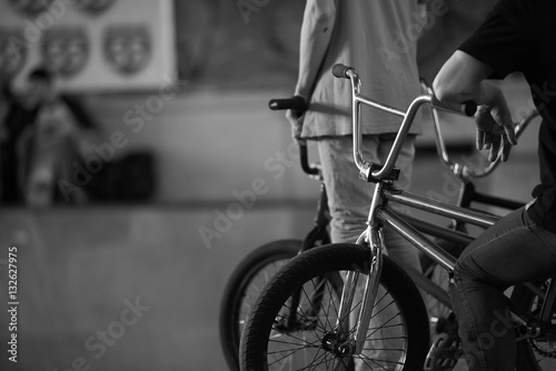 BMX riders in skatepark waiting competition. Extreme live in winter time.