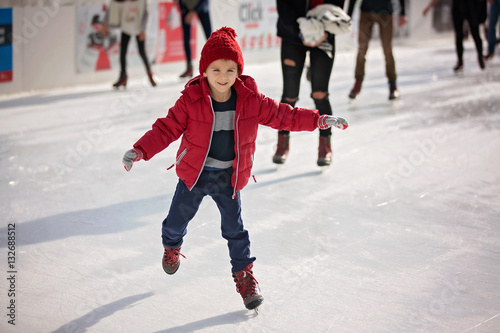 Fotografie, Obraz Happy boy with red hat, skating during the day, having fun