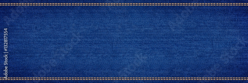 Photo wide blue jeans denim panorama background with stitching