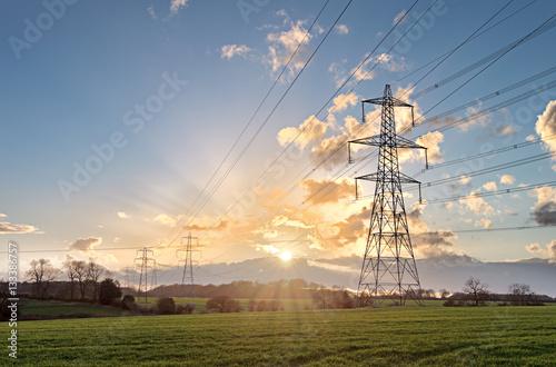 Photo Electricity Pylon - UK standard overhead power line transmission tower at sunset