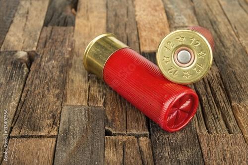 Stampa su Tela 12 gauge red hunting cartridges for shotgun on wooden background
