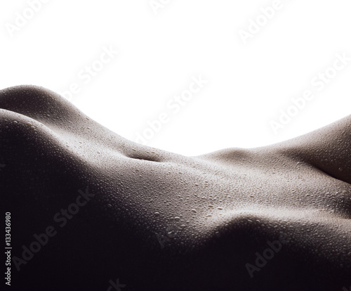 Sexy female body with drops of water