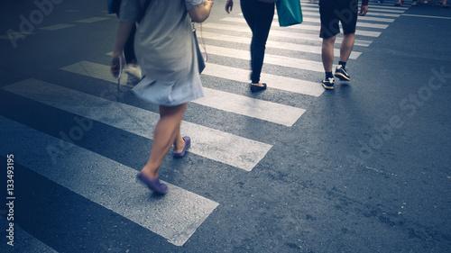Fotografija Motion of pedestrian zebra crossing or crosswalk in asia