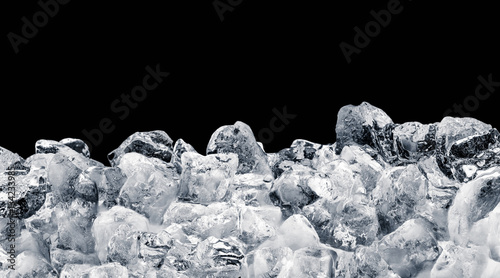 Pieces of crushed ice cubes on black background. Clipping path included.